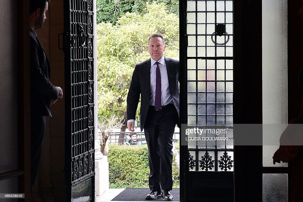 Chairman of the Bank of Greece, Yiannis Stournaras arrives to the prime minister's office in Athens on March 6, 2015 for their meeting, after Athens got no help from the European Central Bank to address a cash squeeze. The ECB recently cut off a key channel of financing for Greek banks, saying it would no longer accept Greek sovereign bonds as collateral for loans. Greek Prime Minister Alexis Tsipras has requested a meeting with European Commission chief Jean-Claude Juncker, a government source said Friday. AFP PHOTO/ LOUISA GOULIAMAKI