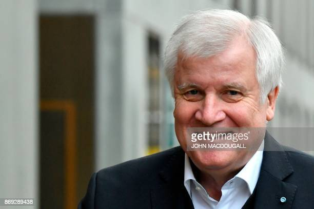 Chairman of the Bavarian Christian Social Union party Horst Seehofer arrives for exploratory talks with members of possible coalition parties to form...