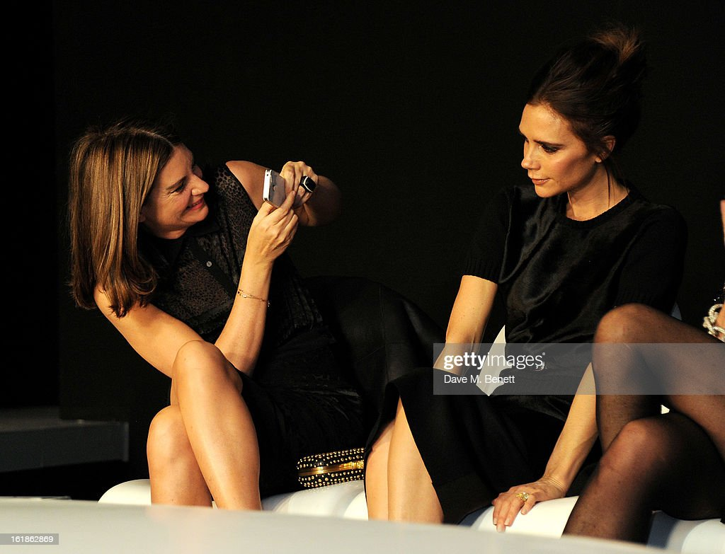 Chairman of the BFC Natalie Massenet (L) and judge Victoria Beckham sit in the front row at the 2013 International Woolmark Prize Final at ME London on February 16, 2013 in London, England.
