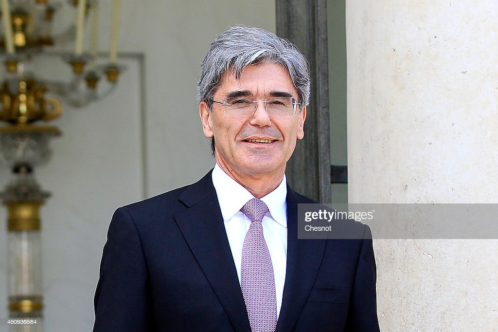 Chairman of the board and C.E.O of the german group Siemens <a gi-track='captionPersonalityLinkClicked' href=/galleries/search?phrase=Joe+Kaeser&family=editorial&specificpeople=558326 ng-click='$event.stopPropagation()'>Joe Kaeser</a>, leaves after a meeting with French President on June 20, 2014, at the Elysee palace in Paris, France. The battle for French group Alstom heated up today, as Siemens-Mitsubishi and General Electric sweetened their rival bids to win over the government and tie-up with the firm's main power-generation division.
