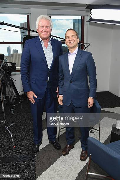 Chairman of the board and chief executive officer of General Electric Jeff Immelt and LinkedIn executive editor Dan Roth pose for a picture at...