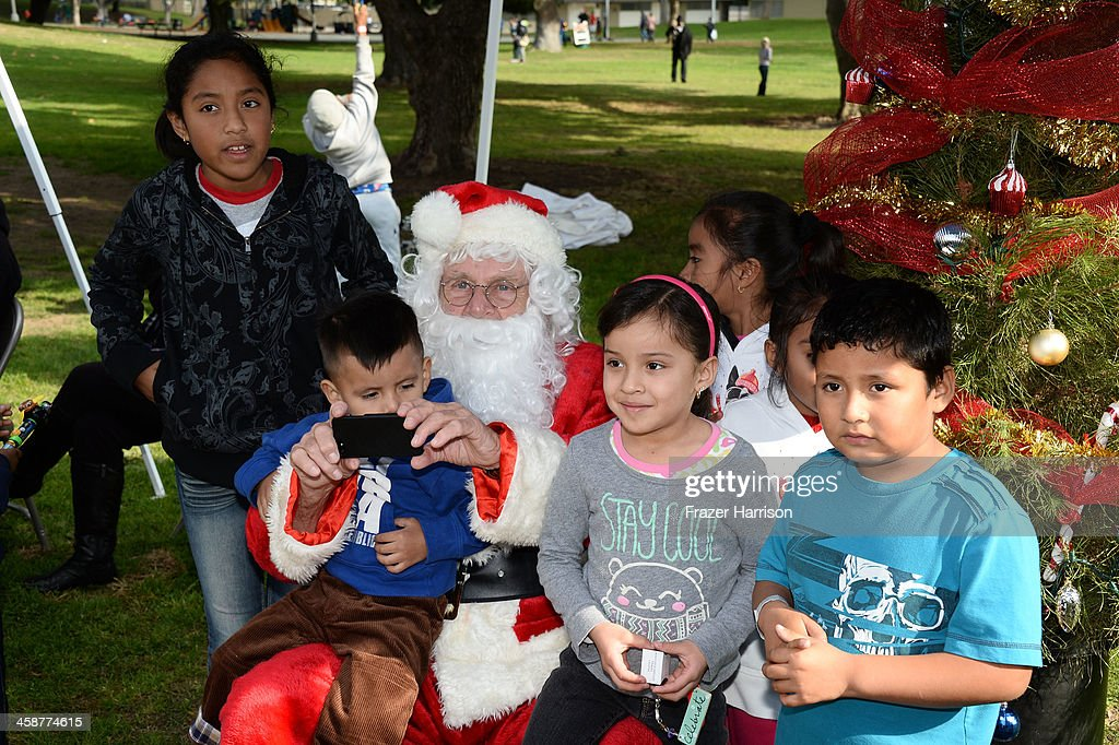 Chairman of the Board Gary Dartnall as Santa at the BAFTA LA Inner City Christmas Party at Athens Park, on December 21, 2013 in Los Angeles, California.