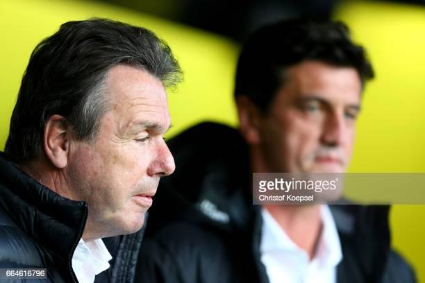 Chairman of the board heribert Bruchhagen and sporting director Jens Todt of Hamburg look on prior to the Bundesliga match between Borussia Dortmund...