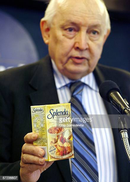 Chairman of the board of Citizens for Health Jim Turner holds a box of the artificial sweetener Splenda during a press conference at the National...