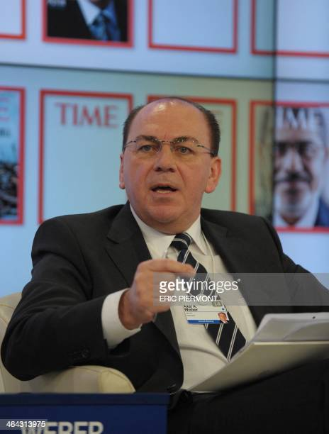 UBS chairman of the board of the directors Axel Weber takes part in a session on the opening day of the World Economic Forum in Davos on January 22...