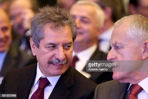 Chairman of the Calik Holding Board of Directors Ahmet Calik speaks with businessman Rona Yircali during 47th General Assembly meeting of Turkish...