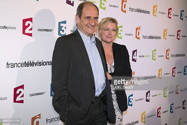 Chairman of the Cannes Film Festival Pierre Lescure and AnneElisabeth Lemoine pose during a photocall for French TV group France Televisions new...