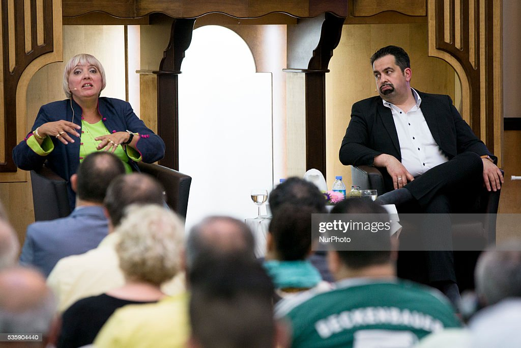 Chairman of the Central Council of Muslims in Germany (ZMD, Zentralrat der Muslime in Deutschland) Aiman Mazyek (R) and Vice-President of German Bundestag Claudia Roth (Buendnis 90/Die Gruenen, L) attend the event 'Toghether against racism' at the Dar Assalam mosque in Berlin on May 30, 2016.