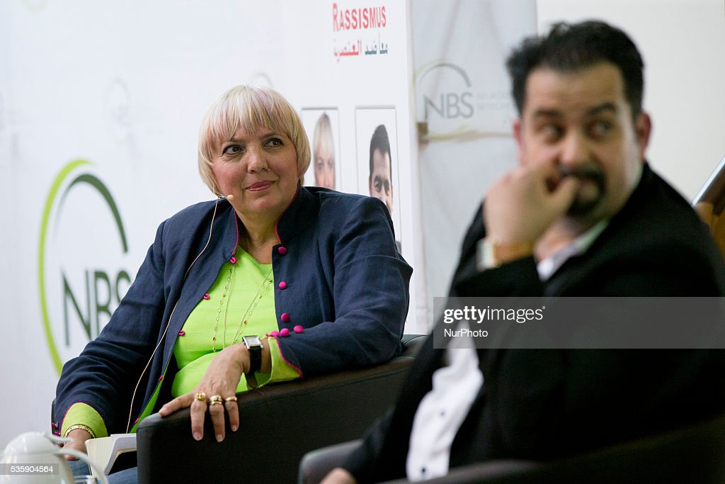 Chairman of the Central Council of Muslims in Germany (ZMD, Zentralrat der Muslime in Deutschland) Aiman Mazyek (R, not in focus) and Vice-President of German Bundestag <a gi-track='captionPersonalityLinkClicked' href=/galleries/search?phrase=Claudia+Roth&family=editorial&specificpeople=235978 ng-click='$event.stopPropagation()'>Claudia Roth</a> (Buendnis 90/Die Gruenen, L) attend the event 'Toghether against racism' at the Dar Assalam mosque in Berlin on May 30, 2016.