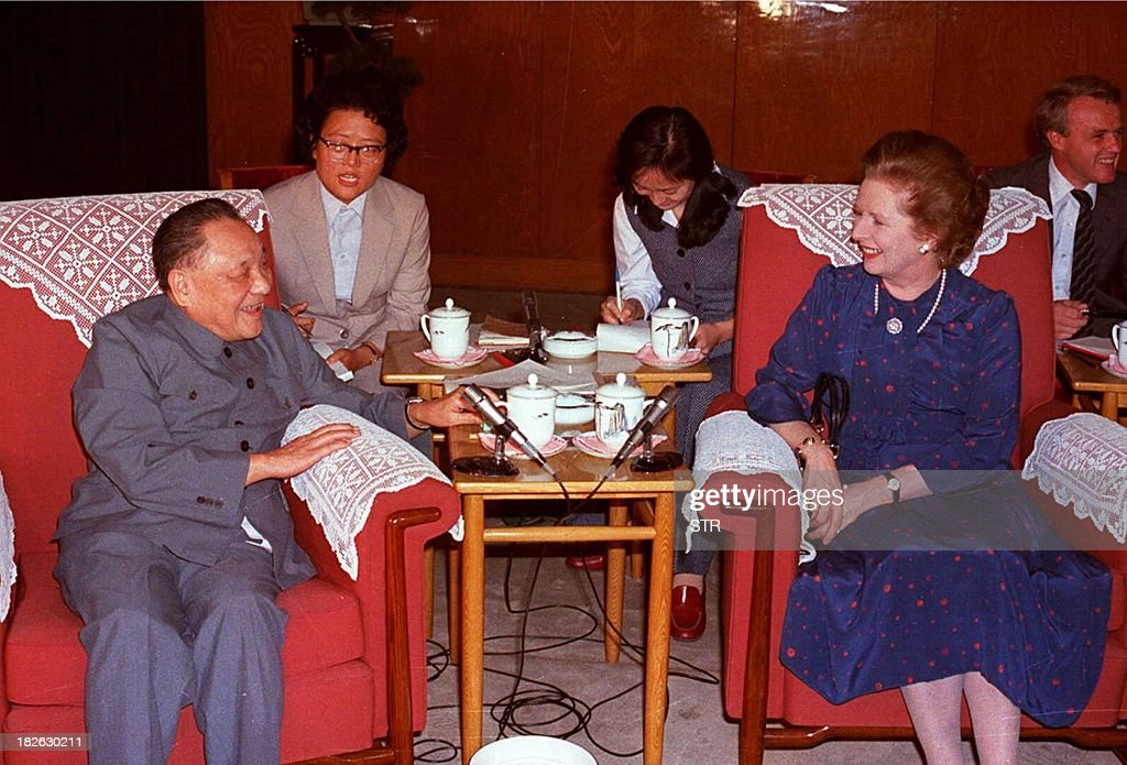 Chairman of the Chinese Communist Party Central Advisory Committee Deng Xiaoping and British Prime Minister Margaret Thatcher talk in a file photo...