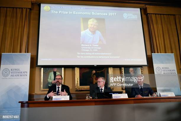 Chairman of the comittee for the Nobel Economics Prize Per Stromberg speaks next to the Secretary General of the Royal Swedish Academy of Sciences...