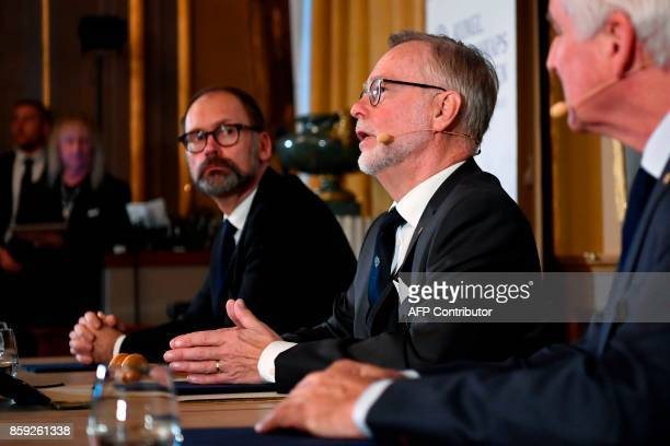 Chairman of the comittee for the Nobel Economics Prize Per Stromberg listens to the Secretary General of the Royal Swedish Academy of Sciences Goran...
