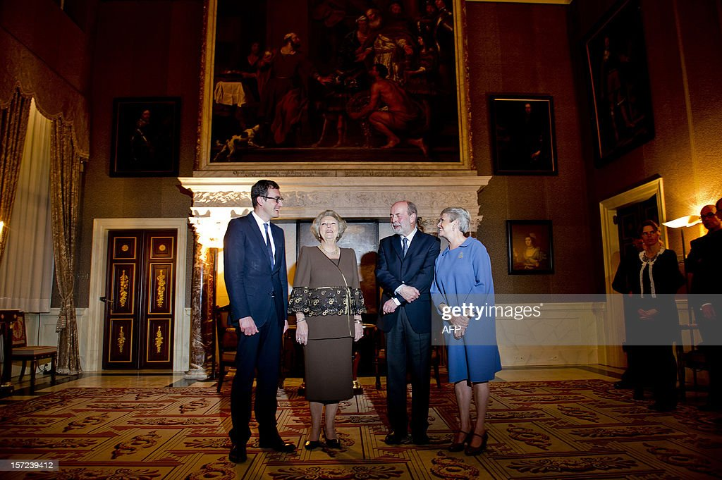 Chairman of the Committee of Ministers Pascal Smet, Dutch Queen Beatrix, the Flemish poet Leonard Nolens and his wife pose in the Royal Palace on the Dam in Amsterdam, on November 30, 2012. Queen Beatrix awarded the Belgium poet Leonard Nolens with the Prize of Dutch Literature. Every three years, the Committee of Ministers of the Dutch Language Union hands out the Prize of Dutch Literature. This award distinguishes major authors with originally written Dutch literary works. AFP PHOTO/ FRANK VAN BEEK netherlands out