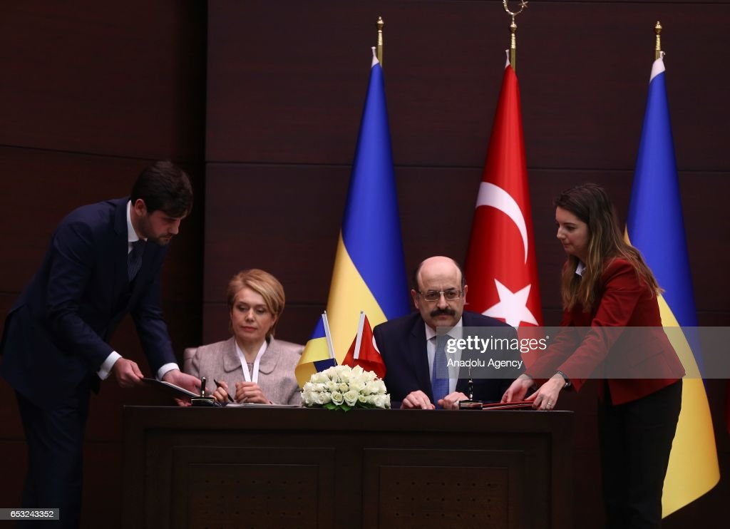 Chairman of the Council of Higher Education of Turkey, Prof. Dr. Yekta Sarac (2nd R) and Ukraine's Minister of Education and Science Liliya Hrynevych (2nd L) sign a memorandum of understanding on higher education during Turkish Prime Minister Binali Yildirim and Prime Minister of Ukraine Volodymyr Groysman meeting in Ankara, Turkey on March 14, 2017.