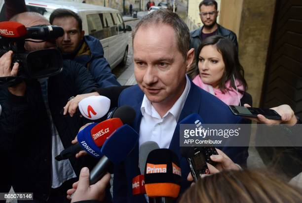 Chairman of the Czech Mayors' movement Petr Gazdik answers journalists' questions as he leaves the parliament after talks with the populist ANO...