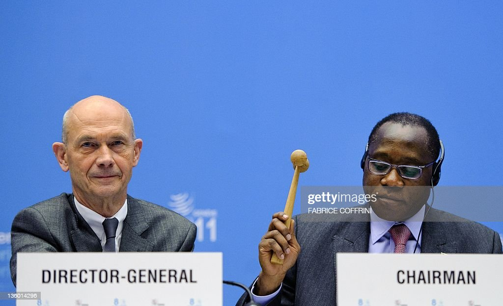 Chairman of the eighth World Trade Organization ministerial conference Nigerian Trade Minister Olusegun Aganga (R) brought the hammer down and declared that the trade body approved Russia's accession next to WTO Director-General Pascal Lamy as the World Trade Organization gave its second and final approval for Russia's membership in the trade body after a record 18-year quest to join, on December 16, 2011 in Geneva. 'The ministerial conference so agrees,' said Nigerian Trade Minister Olusegun Aganga, who is chair of the eighth WTO ministerial conference.