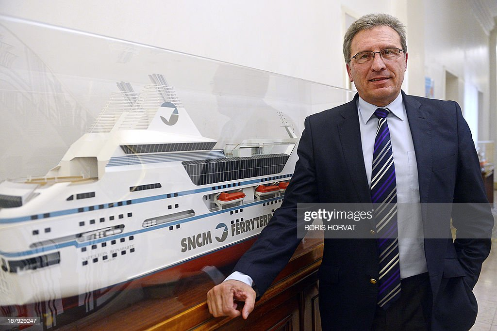 Chairman of the executive board of the maritime transport company Société Nationale Corse Mediterranée (SNCM), Marc Dufour, poses next to a model boat during a press conference on May 2, 2013, after the EU commission ordered France to recover 220 million euros of incompatible public aid received by SNCM. The transport company announced it would make an appeal against the commission's decision.