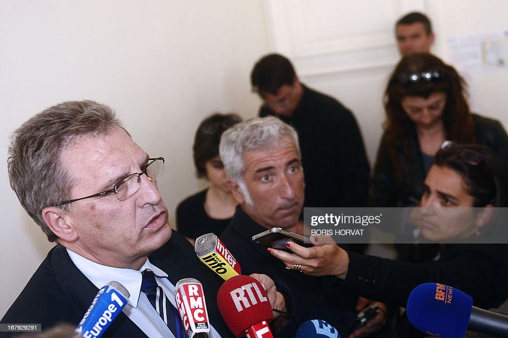 Chairman of the executive board of the maritime transport company Société Nationale Corse Mediterranée (SNCM), Marc Dufour (R), speaks to journalists on May 2, 2013, after the EU commission ordered France to recover 220 million euros of incompatible public aid received by SNCM. The transport company announced it would make an appeal against the commission's decision.