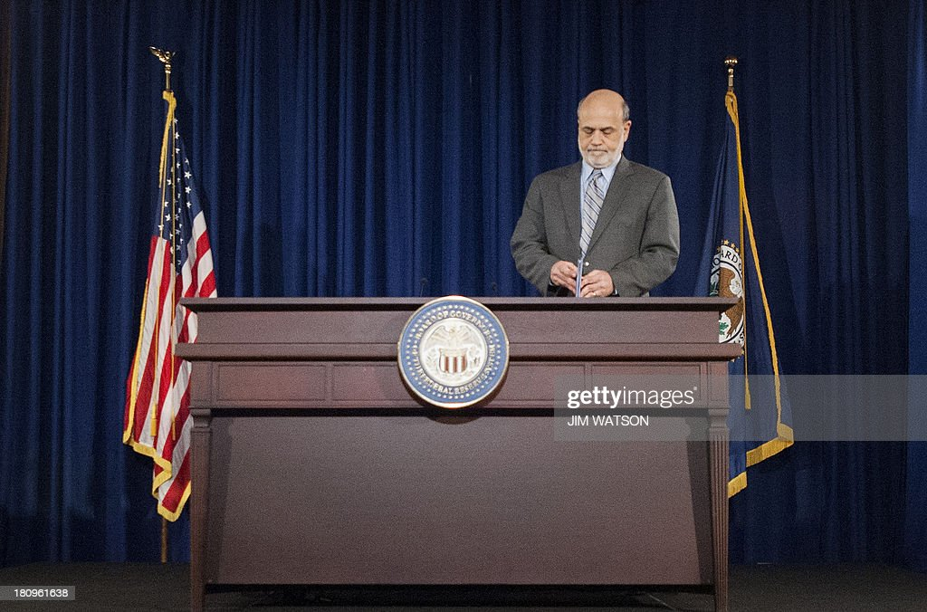 Chairman of the Federal Reserve Ben Bernanke speaks during a news conference in Washington, DC, September 18, 2013. The Federal Reserve cut Wednesday its US economic growth forecasts for this year and 2014 as it unexpectedly left unchanged its massive monetary stimulus. AFP PHOTO/Jim WATSON