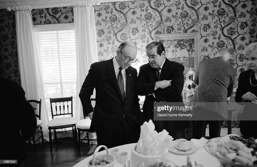 Chairman of the Federal Reserve Board Alan Greenspan (L) and U.S. Supreme Court Justice <a gi-track='captionPersonalityLinkClicked' href=/galleries/search?phrase=Antonin+Scalia&family=editorial&specificpeople=215620 ng-click='$event.stopPropagation()'>Antonin Scalia</a> talk during a gathering for John E. Robson, President and Chairman of the Export-Import Bank of the United States, at Secretary of Defense Donald Rumsfeld's home October 6, 2001 in Washington, D.C.