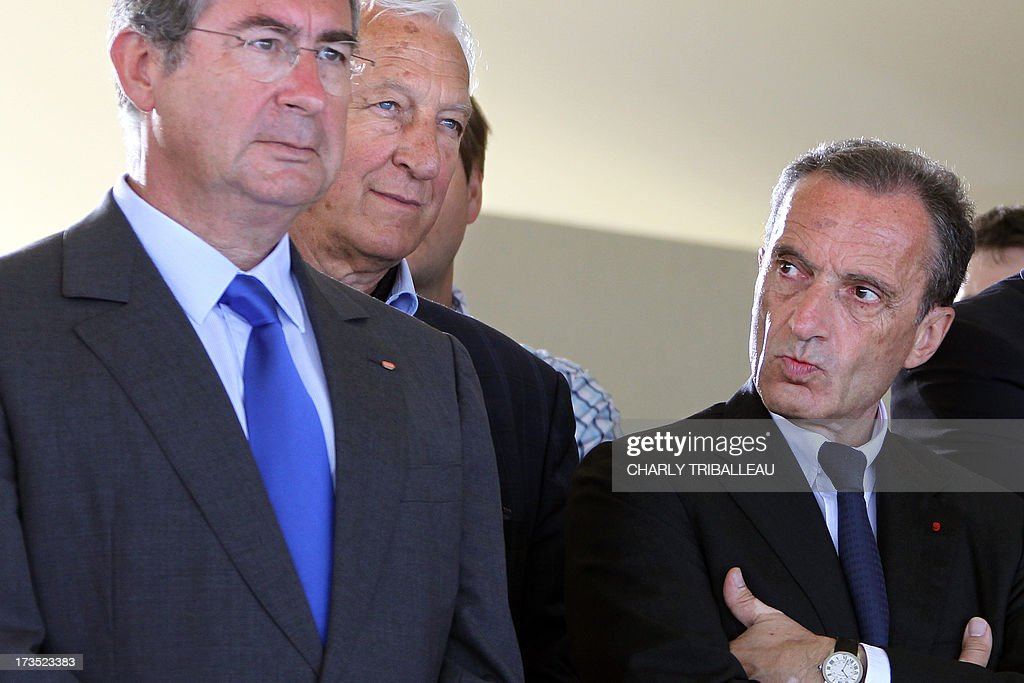 Chairman of the French Bouygues construction giant Martin Bouygues (L) and France's state-owned electricity company EDF CEO Henri Proglio (R) attend on July 16, 2013 in Flamanville, northwestern France, the installattion of a dome on the reactor's building on the construction site of the third European generation Pressurised Reactor (EPR). The nuclear reactor will be put into service at the end of the year 2016, said EDF director of the future nuclear station Didier Ohayon on June 20, 2013.