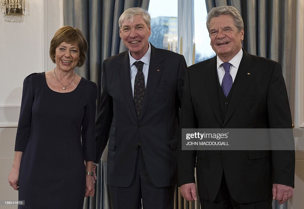 Chairman of the German Confederation of Trade Unions (DGB) Michael Sommer (C) poses with German President Joachim Gauck (R) and his partner Daniela Schadt during an annual New Year reception at the Presidential Palace in Berlin January 10, 2013.