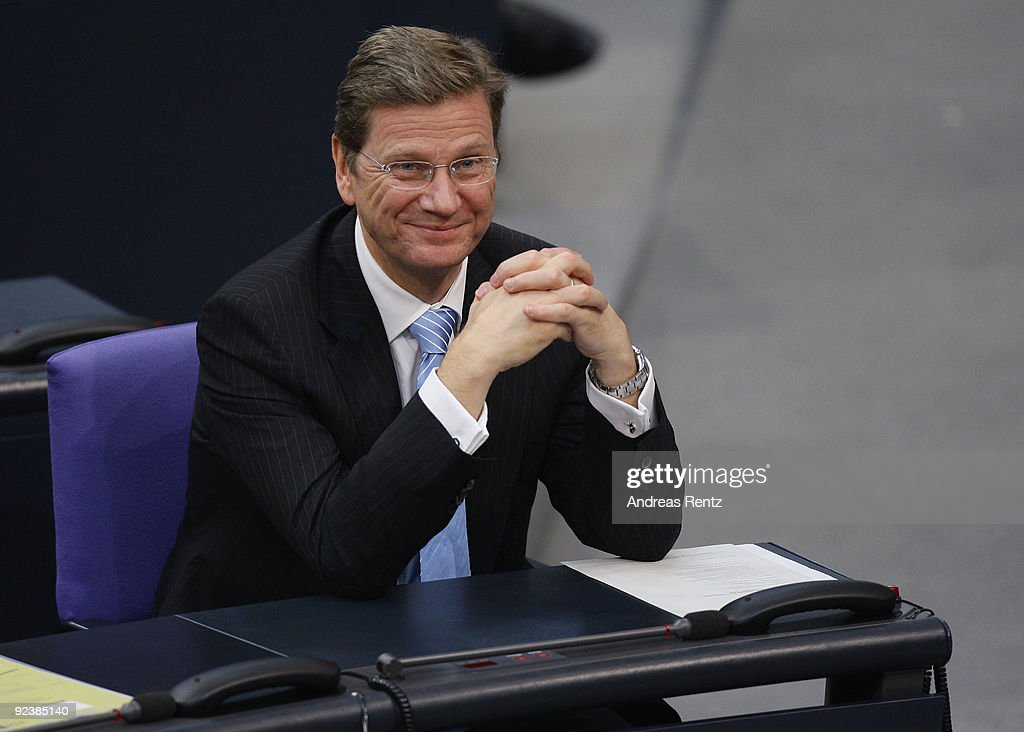 Chairman of the German Free Democrats (FDP) and new German Vice Chancellor and Foreign Minister designate <a gi-track='captionPersonalityLinkClicked' href=/galleries/search?phrase=Guido+Westerwelle&family=editorial&specificpeople=208748 ng-click='$event.stopPropagation()'>Guido Westerwelle</a> attends the first session of the new Bundestag on October 27, 2009 in Berlin, Germany. The FDP and the CDU/CSU have agreed on the creation of a coalition government following elections in September.