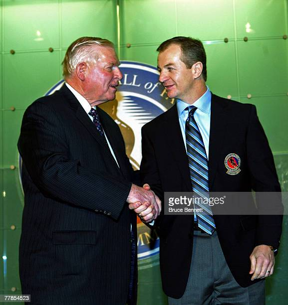 Chairman of the Hockey Hall of Fame Bill Hay presents the Hall ring to Al MacInnis at the Hockey Hall of Fame press conference and photo opportunity...