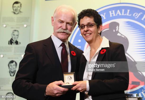 Chairman of the Hockey Hall of Fame Lanny McDonald presents Danielle Goyette with the Hall ring during a media opportunity at the Hockey Hall Of Fame...