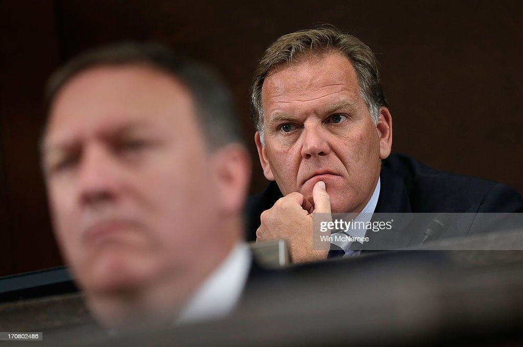 Chairman of the House Select Intelligence Committee, Rep. Mike Rogers (R-MI) (R) listens to testimony from national security officials June 18, 2013 in Washington, DC. The committee heard testimony on the topic of 'how the disclosed NSA programs protect Americans from terror attacks on US soil, and why the disclosure of that classified information aids our adversaries.'