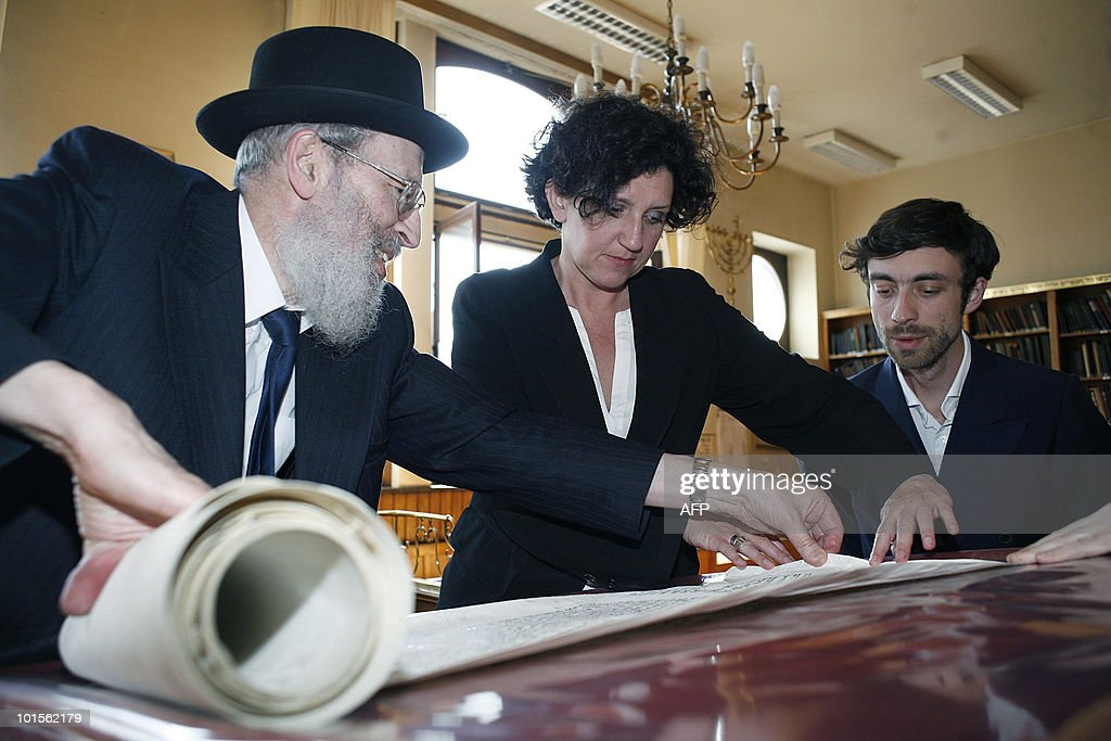 Chairman of the jewish orthodox community Pinkas Kornfeld, Belgium's outgoing Interior Minister and member of the Open Flemish Liberals and Democrats party (Open VLD) Annemie Turtelboom and Open Vld chamber member Willem Frederik Schiltz watch Torah scrolls during a visit to the synagoge in the Oostenstraat (Oosten street) of Antwerp, on June 2, 2010, few days after five valuable Torah scrolls (thorarollen) were stolen from the synagoge.