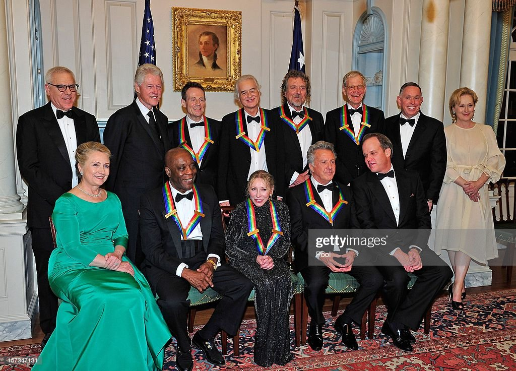 Chairman of the John F. Kennedy Center for the Performing Arts, David M. Rubenstein, former U.S. President Bill Clinton, John Paul Jones, Jimmy Page, Robert Plant, David Letterman, President of the John F. Kennedy Center for the Performing Arts Michael M. Kaiser and Meryl Streep. (L-R Front Row) U.S. Secretary of State Hillary Rodham Clinton, Buddy Guy, Natalia Makarova, Dustin Hoffman and Michael Stevens, producer of the annual Kennedy Center Honors following a dinner for Kennedy honorees hosted by U.S. Secretary of State Hillary Rodham Clinton at the U.S. Department of State on December 1, 2012 in Washington, DC. The 2012 honorees are Buddy Guy, actor Dustin Hoffman, late-night host David Letterman, dancer Natalia Makarova, and members of the British rock band Led Zeppelin Robert Plant, Jimmy Page, and John Paul Jones.