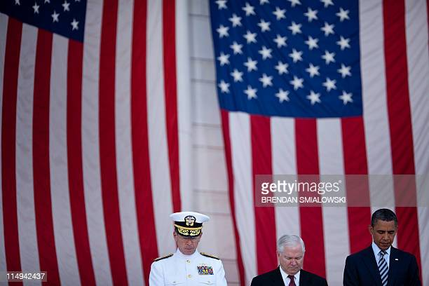 Chairman of the Joint Chiefs of Staff Admiral Mike Mullen and Secretary of Defense Robert M Gates and US President Barack Obama bow their heads...