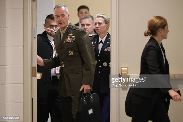 Chairman of the Joint Chiefs of Staff Gen Joseph Dunford leaves a classified briefing for members of the US Senate at the US Capitol Visitors Center...