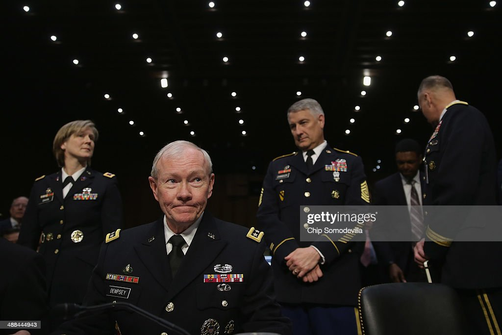 Chairman of the Joint Chiefs of Staff Gen. <a gi-track='captionPersonalityLinkClicked' href=/galleries/search?phrase=Martin+Dempsey&family=editorial&specificpeople=2116621 ng-click='$event.stopPropagation()'>Martin Dempsey</a> (2nd L) prepares to testify before the Senate Armed Services Committee with other members of the U.S. military Joint Chiefs of Staff on Capitol Hill May 6, 2014 in Washington, DC. Joined by senior enlisted officers, the Joint Chiefs testified about proposals relating to military compensation.