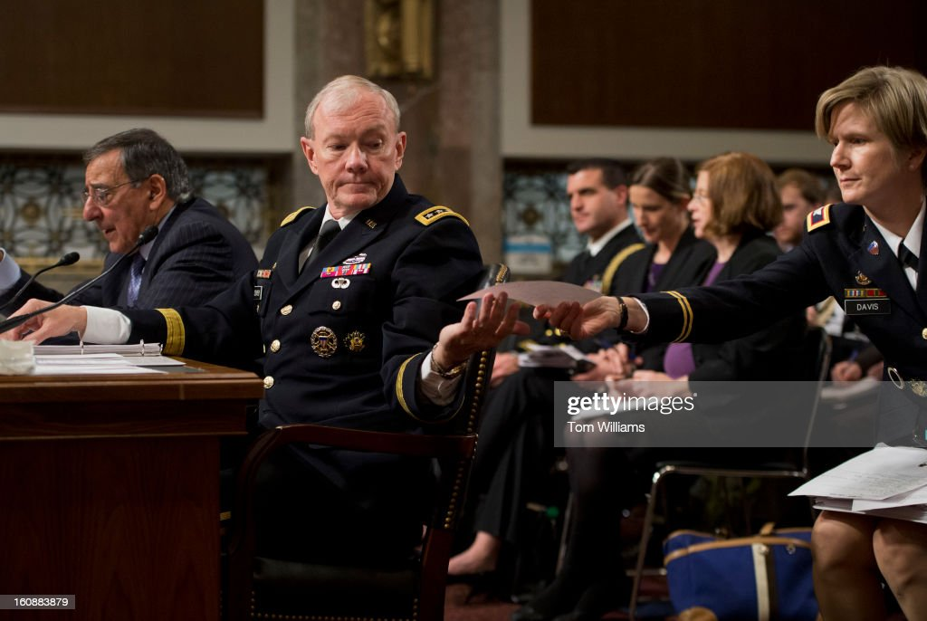 Chairman of the Joint Chiefs of Staff Gen. Martin Dempsey, receives a note from an aide during a Senate Armed Services Committee hearing on the Defense Department's response to the attack on U.S. embassy in Benghazi, Libya, and discuss the findings of its internal review of the attack. Secretary of Defense Leon Panetta also testified.