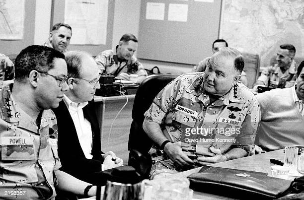 Chairman of the Joint Chiefs of Staff General Colin Powell Secretary of Defense Dick Cheney and CENTCOM Commander General Norman Schwarzkopf discuss...