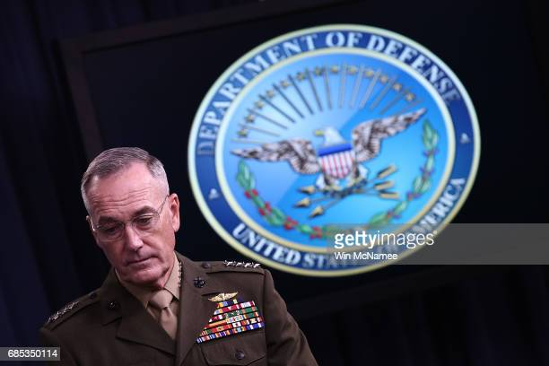 Chairman of the Joint Chiefs of Staff Marine Gen Joseph F Dunford Jr answers questions during a Pentagon briefing May 19 2017 in Arlington Virginia...