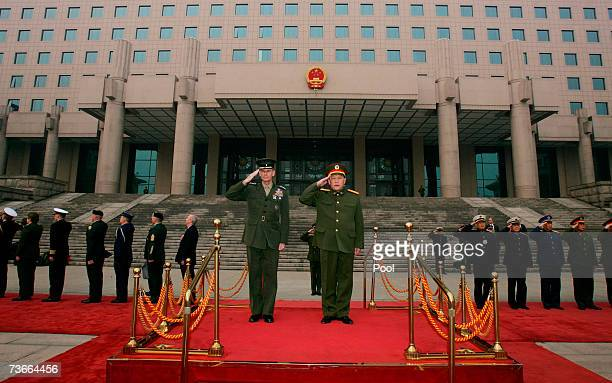 S Chairman of the Joint Chiefs of Staff Marine Gen Peter Pace and Gen Liang Guanglie listen to their national anthems during a welcome ceremony at...