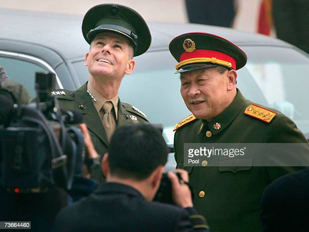 S Chairman of the Joint Chiefs of Staff Marine Gen Peter Pace and Gen Liang Guanglie smile during a welcome ceremony at the Defense Ministry in March...