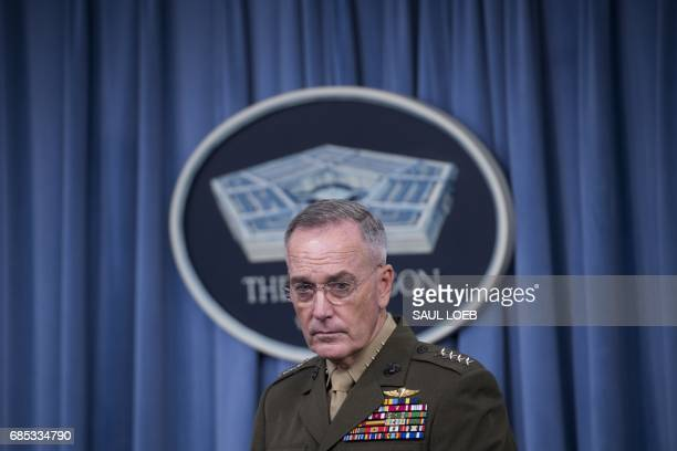 Chairman of the Joint Chiefs of Staff Marine General Joseph Dunford holds a press briefing at the Pentagon in Washington DC May 19 2017 Pentagon...