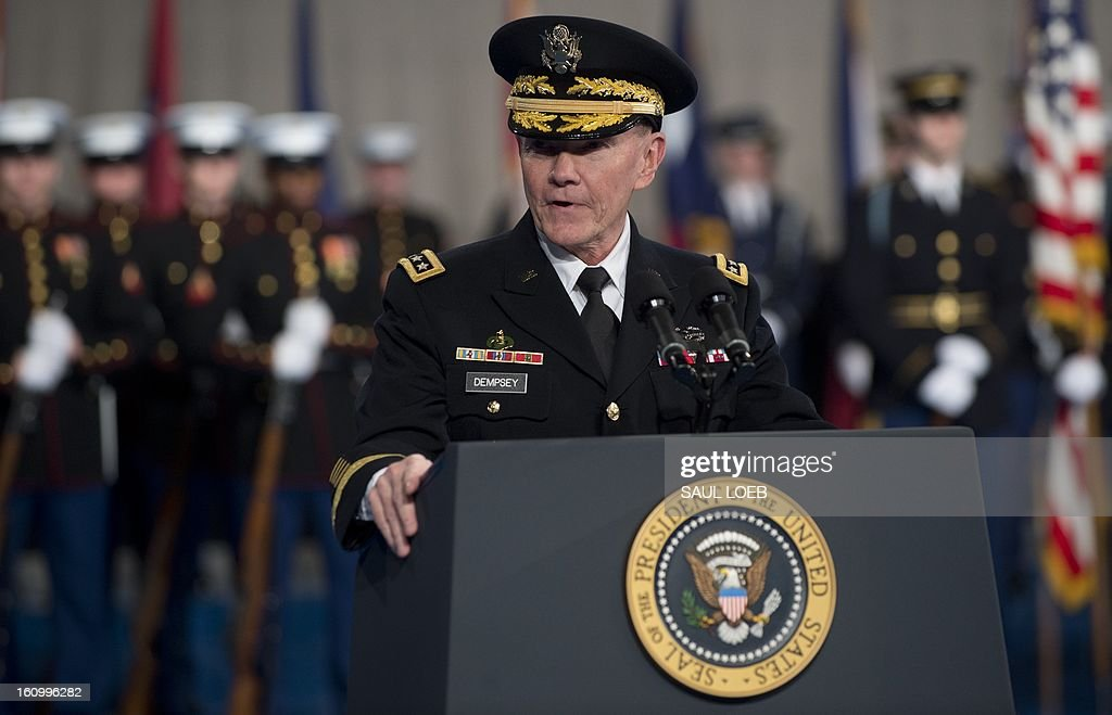 Chairman of the Joint Chiefs of Staff Martin Dempsey speaks during an Armed Forces Farewell Tribute in honor of outgoing Secretary of Defense Leon Panetta at Joint Base Myer-Henderson in Arlington, Virginia, February 8, 2013. Panetta will retire once his likely successor, former Nebraska Senator Chuck Hagel, is confirmed by the US Senate. AFP PHOTO / Saul LOEB