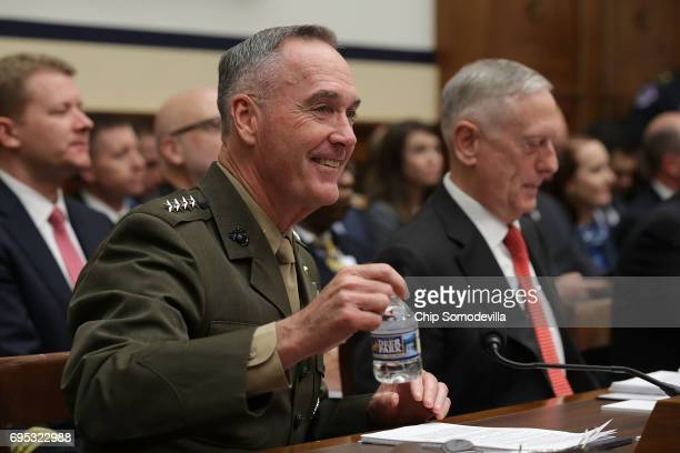 Chairman of the Joint Chiefs of Staff USMC Gen Joseph Dunford and US Defense Secretary James Mattis prepare to testify before the House Armed...