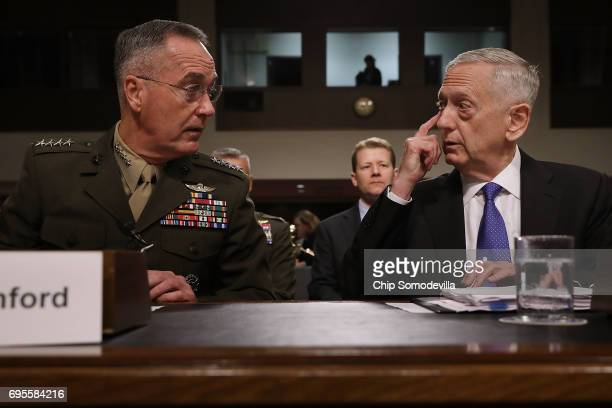 Chairman of the Joint Chiefs of Staff USMC Gen Joseph Dunford and US Defense Secretary James Mattis prepare to testify before the Senate Armed...