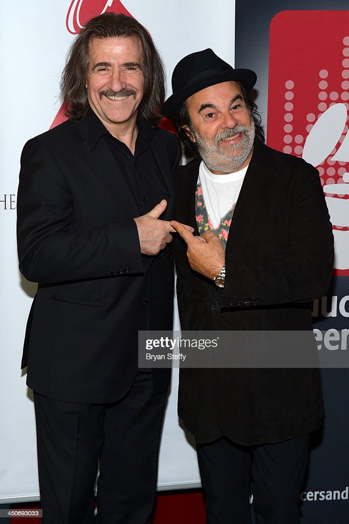 Chairman of the Latin Recording Academy <a gi-track='captionPersonalityLinkClicked' href=/galleries/search?phrase=Luis+Cobos&family=editorial&specificpeople=650002 ng-click='$event.stopPropagation()'>Luis Cobos</a> and producer Moogie Canazio attend the P&E Wing Latin GRAMMY Celebration during the 14th annual Latin GRAMMY Awards on November 19, 2013 at the Palms Casino Resort in Las Vegas, Nevada.