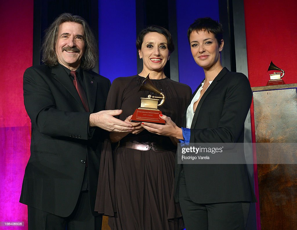 Chairman of The Latin Recording Academy Luis Cobos (L) and singer/songwriter Vega (R) present a Lifetime Achievement Award to singer Luz Casal (C) during the 2012 Latin Recording Academy Special Awards during the 13th annual Latin GRAMMY Awards at the Four Seasons Hotel on November 14, 2012 in Las Vegas, Nevada.
