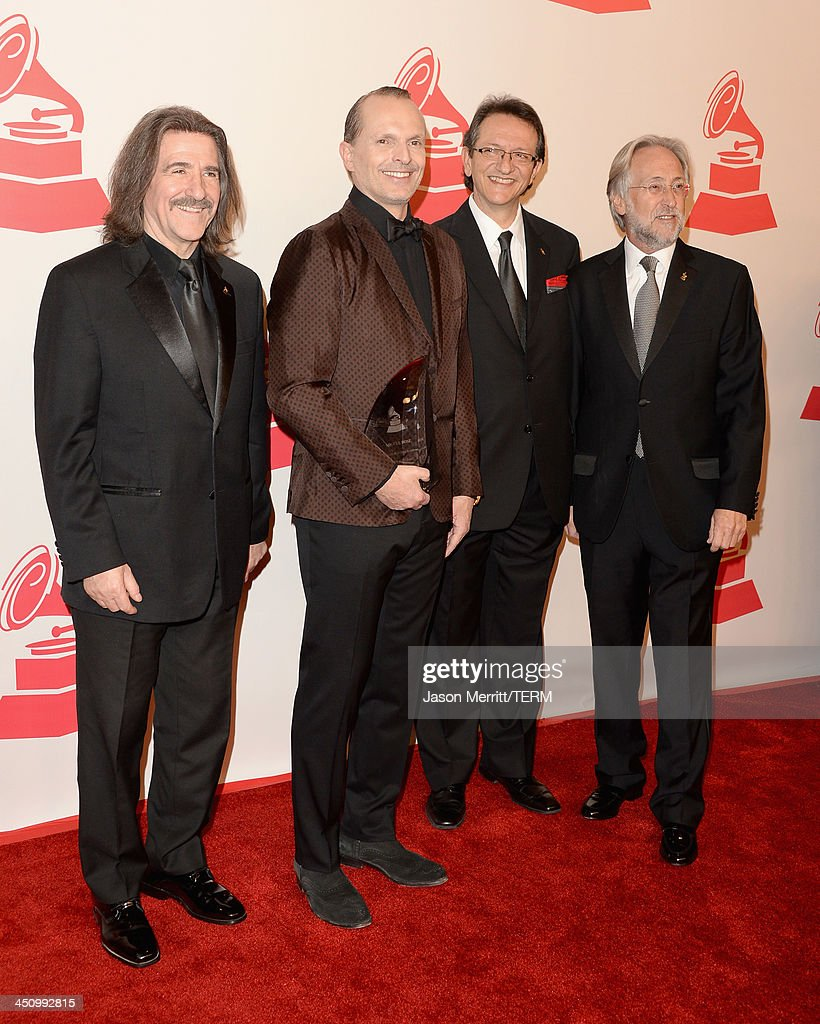 Chairman of the Latin Recording Academy <a gi-track='captionPersonalityLinkClicked' href=/galleries/search?phrase=Luis+Cobos&family=editorial&specificpeople=650002 ng-click='$event.stopPropagation()'>Luis Cobos</a>, Honoree <a gi-track='captionPersonalityLinkClicked' href=/galleries/search?phrase=Miguel+Bose&family=editorial&specificpeople=577901 ng-click='$event.stopPropagation()'>Miguel Bose</a>, President and CEO of the Latin Recording Academy <a gi-track='captionPersonalityLinkClicked' href=/galleries/search?phrase=Gabriel+Abaroa&family=editorial&specificpeople=691921 ng-click='$event.stopPropagation()'>Gabriel Abaroa</a> and President of National Academy of Recording Arts and Sciences <a gi-track='captionPersonalityLinkClicked' href=/galleries/search?phrase=Neil+Portnow&family=editorial&specificpeople=208909 ng-click='$event.stopPropagation()'>Neil Portnow</a> arrive at the 2013 Latin Recording Academy Person Of The Year honoring <a gi-track='captionPersonalityLinkClicked' href=/galleries/search?phrase=Miguel+Bose&family=editorial&specificpeople=577901 ng-click='$event.stopPropagation()'>Miguel Bose</a> at the Mandalay Bay Convention Center on November 20, 2013 in Las Vegas, Nevada.