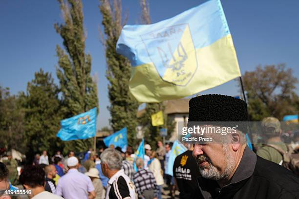Chairman of the Mejlis of the Crimean Tatar people Refat Chubarov is seen on the crowd blocking the entry of lorries at border crossing point...