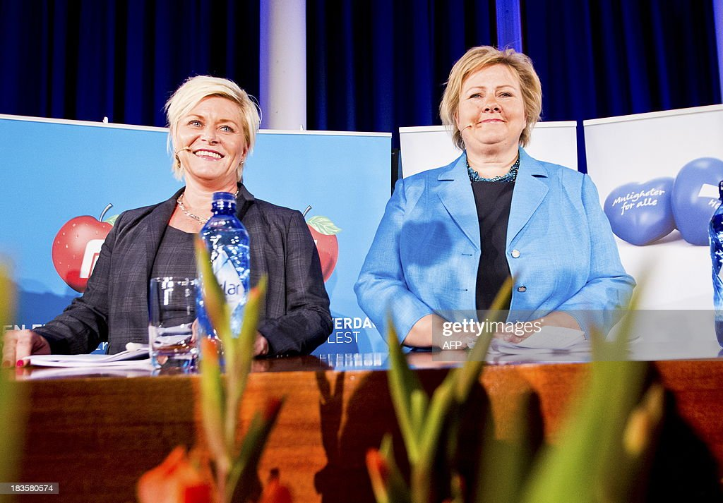 Chairman of the Norwegian Conservative Party, Erna Solberg (R) and chairman of the Progress Party, Siv Jensen attend a press conference on October 7, 2013 in Sunnvollen to announce they have agreed on a platform on which to form a new government in Norway. The new government is expected to take office around October 18, 2013. AFP Photo / Vegard Grott / NTB scanpix / NORWAY OUT