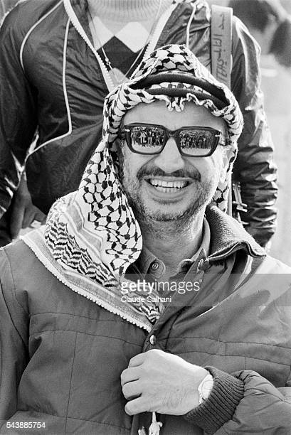 Chairman of the Palestine Liberation Organization Yasser Arafat attends a manifestation celebrating the 13th anniversary of the Palestinian...